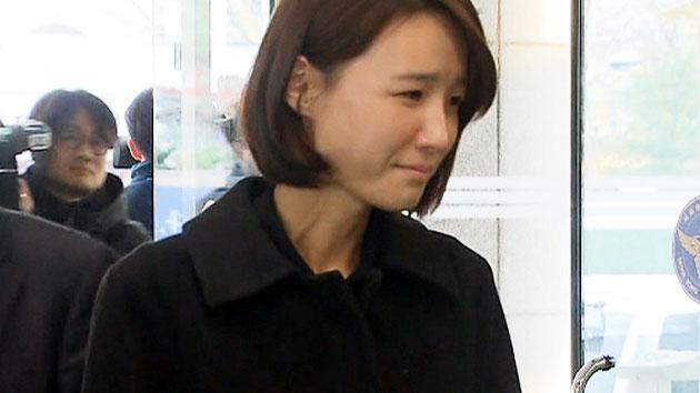 故 신해철 부인, 눈물 흘리며 경찰 출석