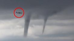 거대한 토네이도 피해 아찔한 비행하는 여객기