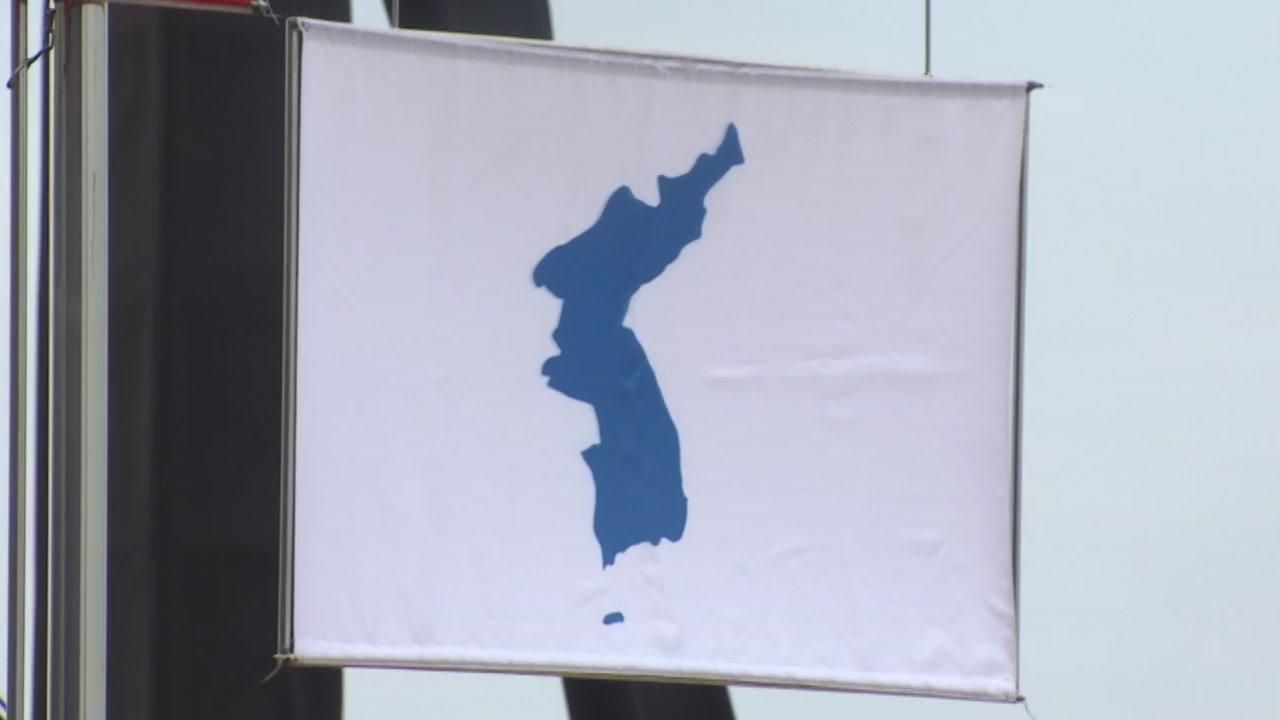 카누단일팀 값진 동메달...첫 한반도기 게양